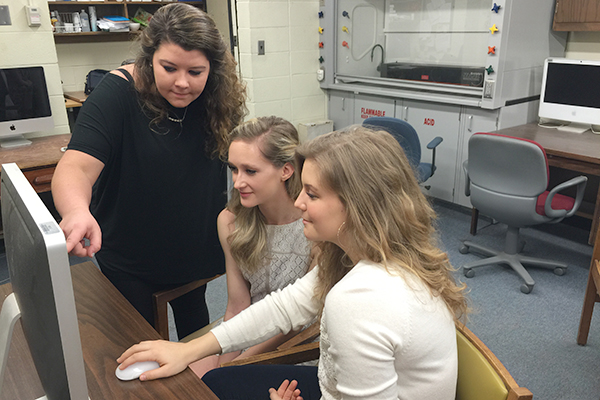 UM BS Chemistry majors (from left) Ashley Williams, Sarah Sutton and Katelyn Allen conduct undergraduate research.